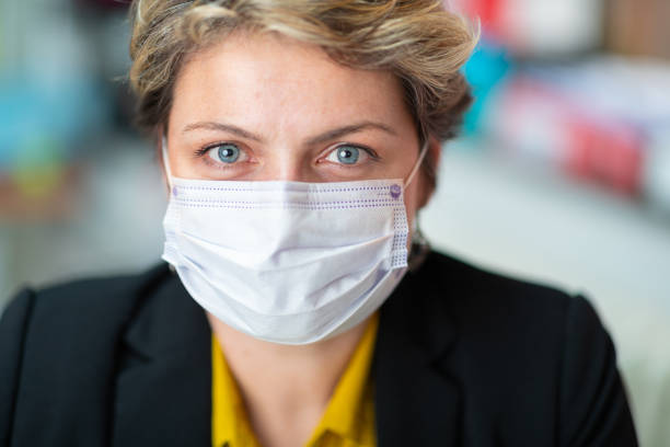 Businesswoman wearing protective face mask stock photo
