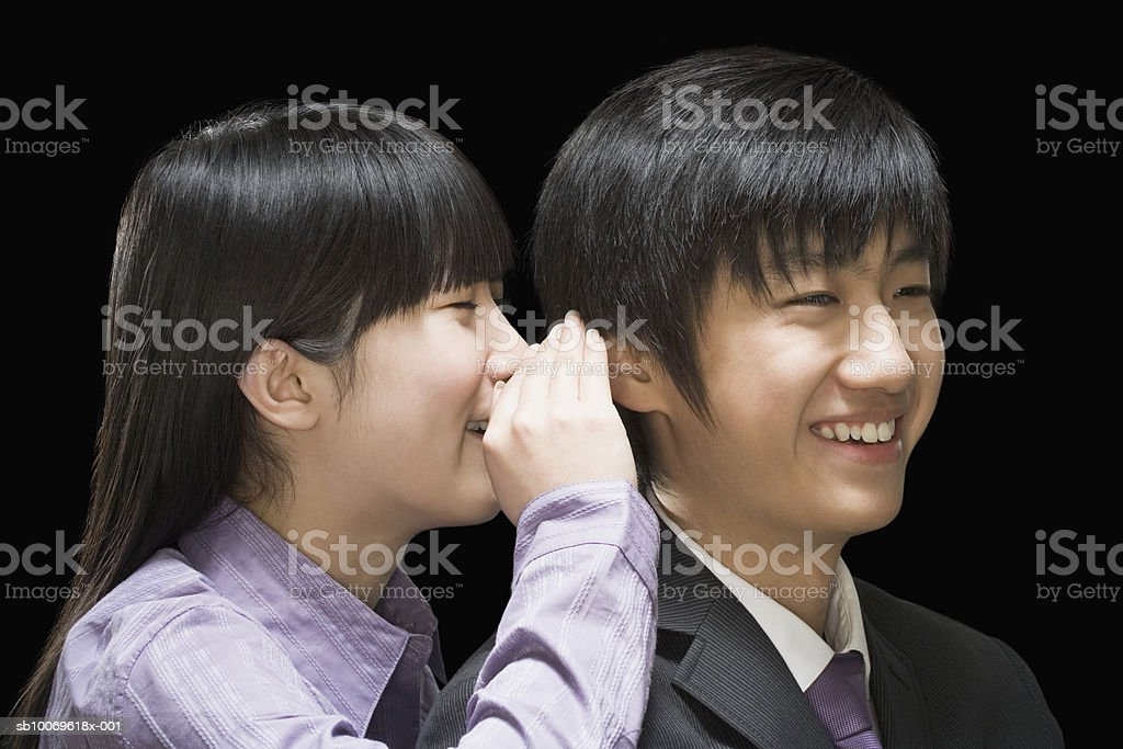 Businesswoman whispering in businessman's ears royalty-free 스톡 사진