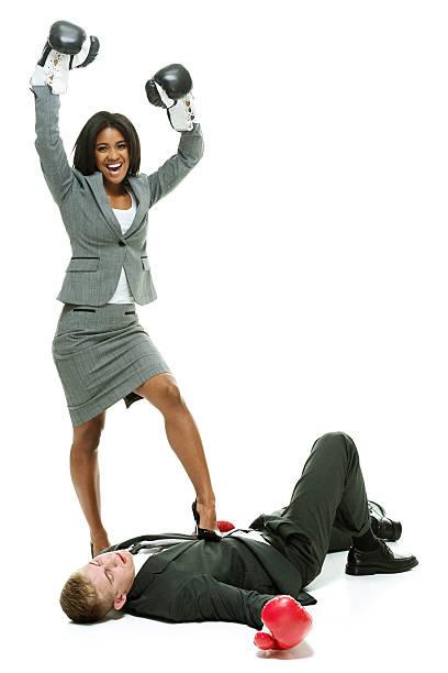 Businesswoman wins over businessman stock photo
