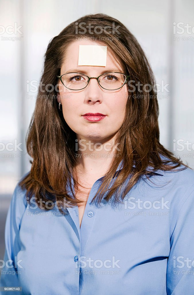 Businesswoman with a blank note on her forehead royalty-free stock photo