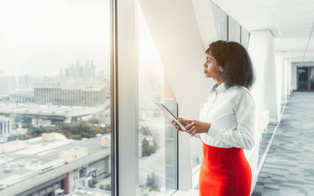 Businesswoman with a digital tablet stock photo