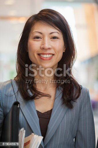 519052198 istock photo Businesswoman with a newspaper and briefcase 519045978