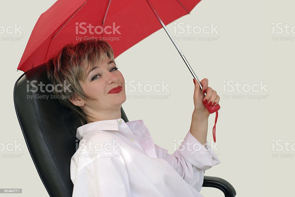 Businesswoman with a red umbrella royalty-free stock photo