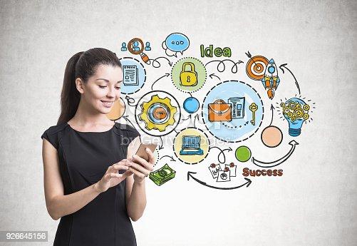 istock Businesswoman with a smartphone, scheme 926645156