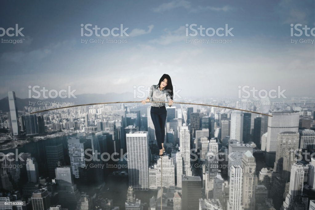 Businesswoman with a stick over a big city stock photo