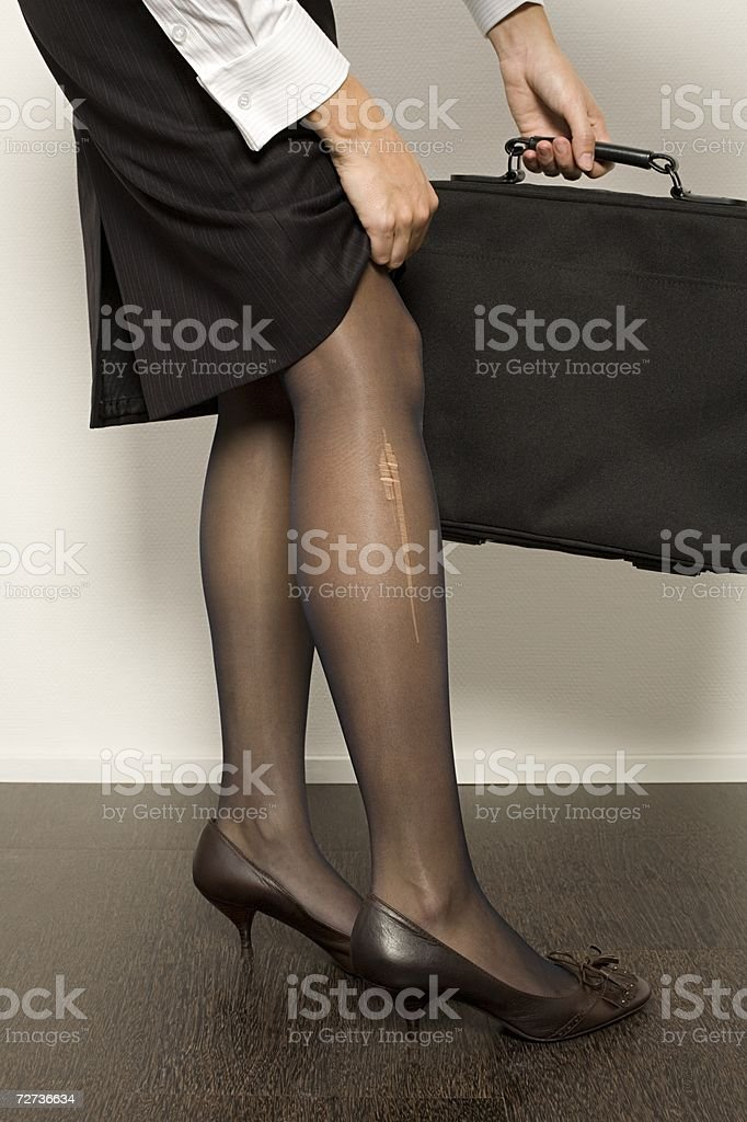 Businesswoman with a stocking ladder royalty-free stock photo
