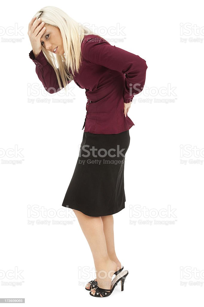 Businesswoman with Aching Back and Head royalty-free stock photo