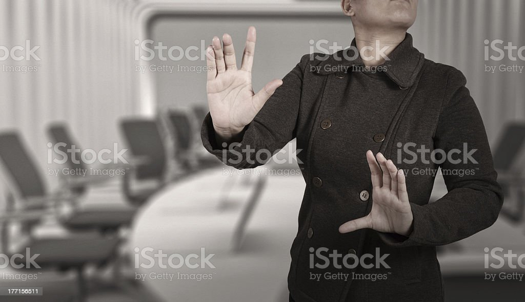 businesswoman with an open hand as showing something royalty-free stock photo