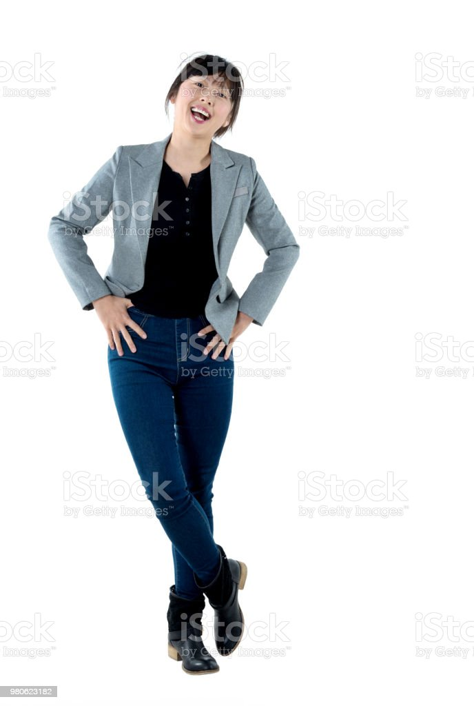 Businesswoman with arms akimbo on white background stock photo