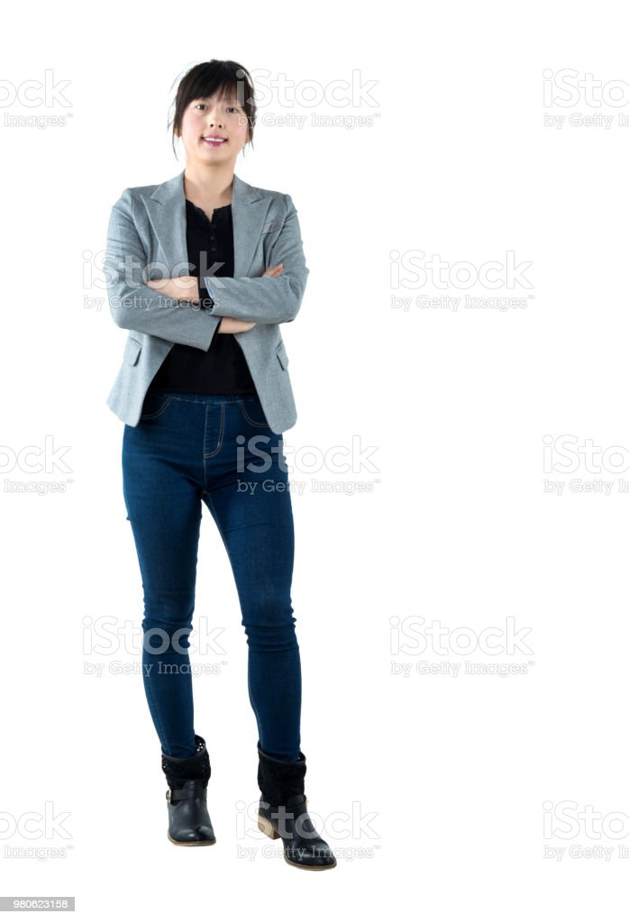 Businesswoman with arms crossed on white background stock photo