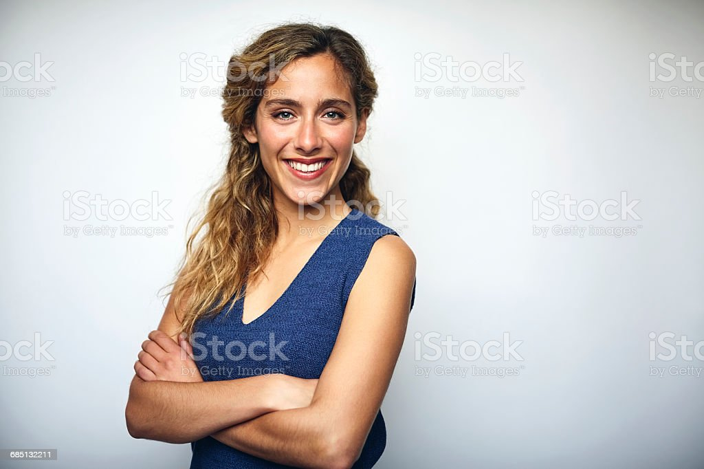 Businesswoman with arms crossed over white stock photo
