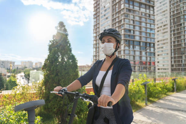 Businesswoman with bicycle Businesswoman with bicycle ebike stock pictures, royalty-free photos & images