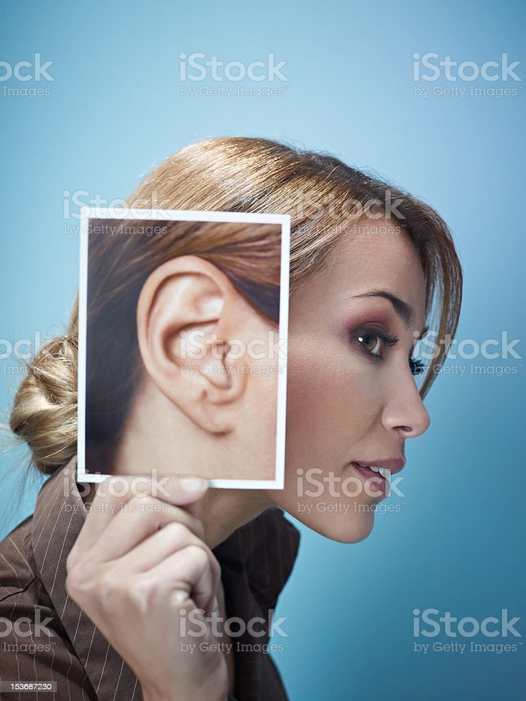 businesswoman with big ears stock photo