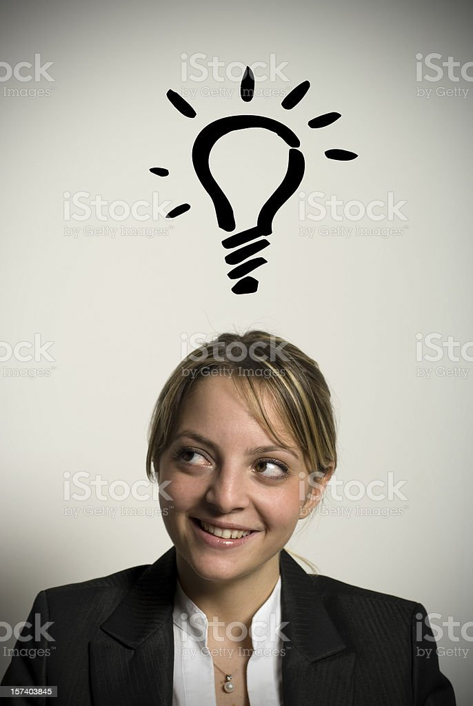 Businesswoman with big idea at desk, Istanbul, Turkey royalty-free stock photo