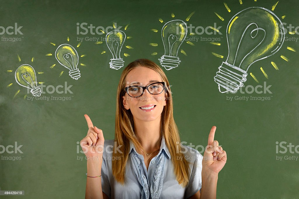 Businesswoman with big ideas stock photo