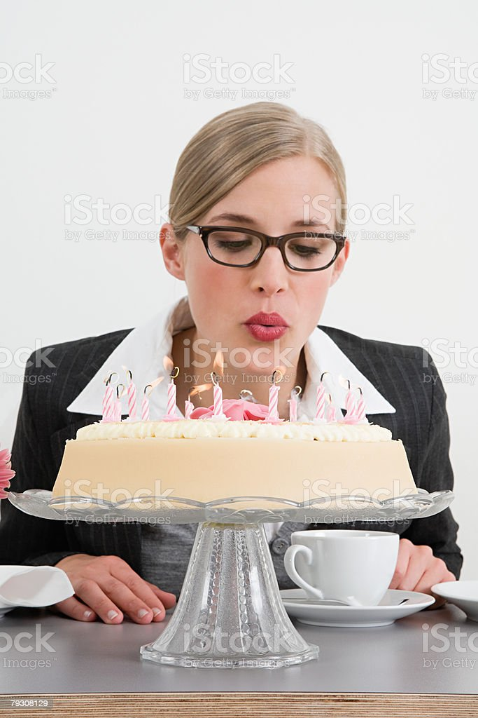 Businesswoman with birthday cake royalty-free stock photo