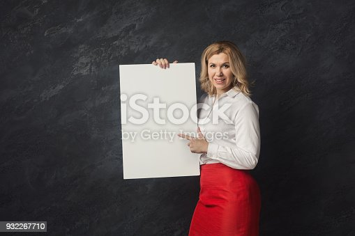 1168002879 istock photo Businesswoman with blank white paper 932267710