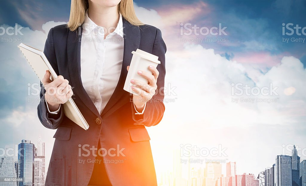 Businesswoman with blond hair and cup of coffee royalty-free stock photo