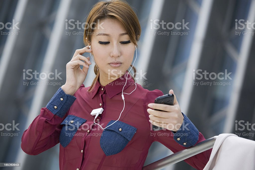 Businesswoman with bluetooth and palmtop royalty-free stock photo