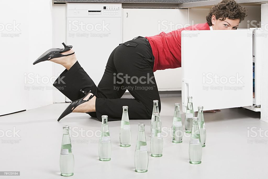 Businesswoman with bottles of water on the floor 免版稅 stock photo