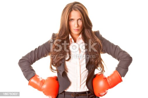 istock Businesswoman with boxing gloves 186750631