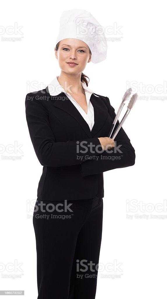 Donna d affari con Cappello da cuoco e Tenaglie isolato su sfondo bianco  foto stock 90ee1efa24a9