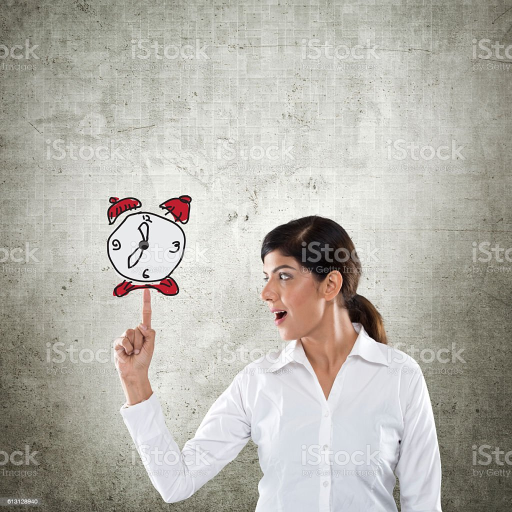 Businesswoman with clock - time concept stock photo