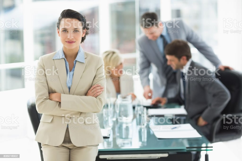 Businesswoman with colleagues discussing in office stock photo