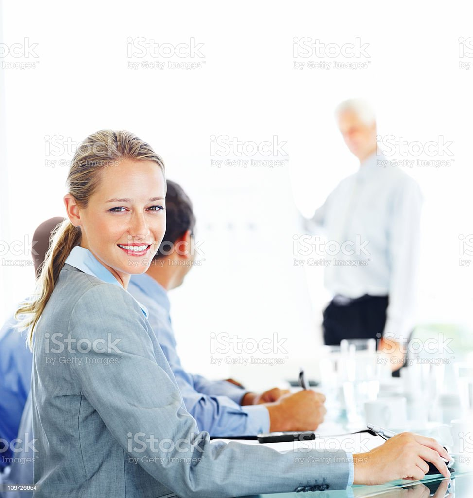 Businesswoman with colleagues in a board room royalty-free stock photo
