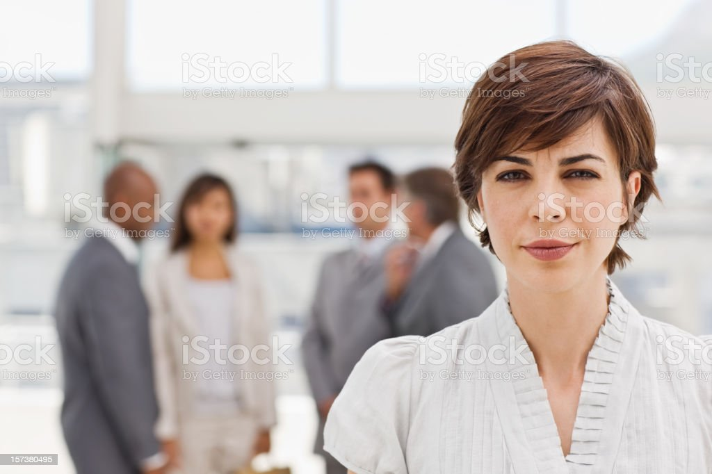 Businesswoman with colleagues in the background royalty-free stock photo