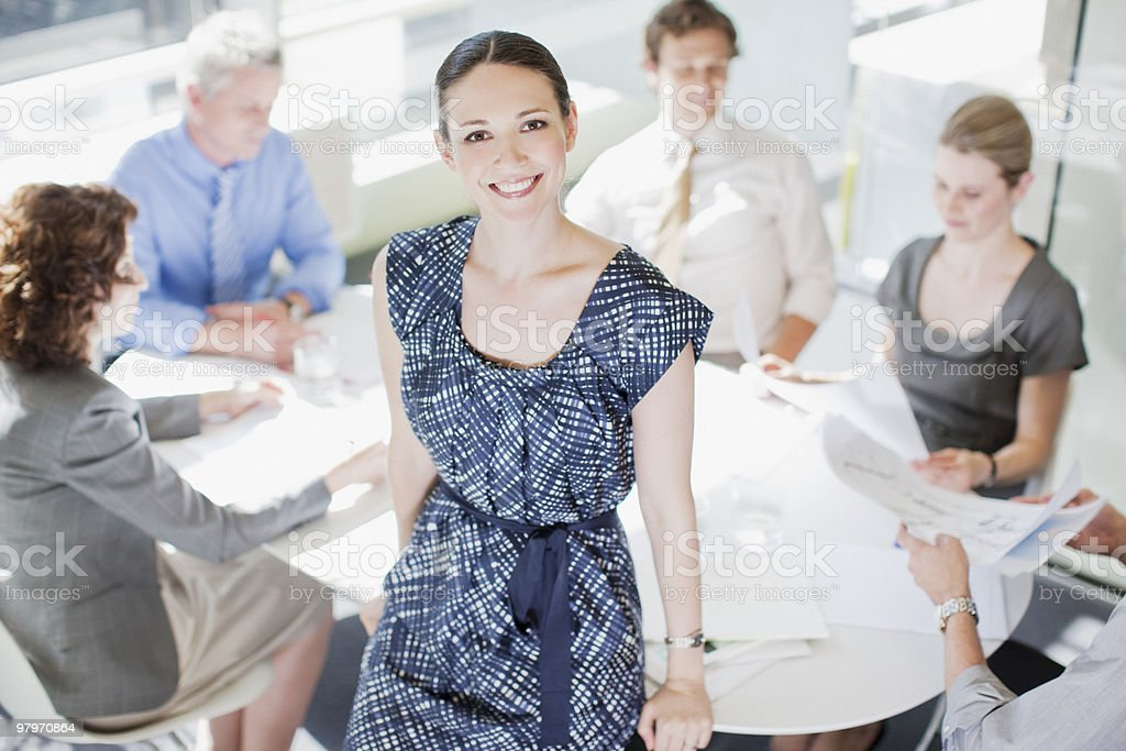 Businesswoman with co-workers meeting at conference table royalty-free stock photo