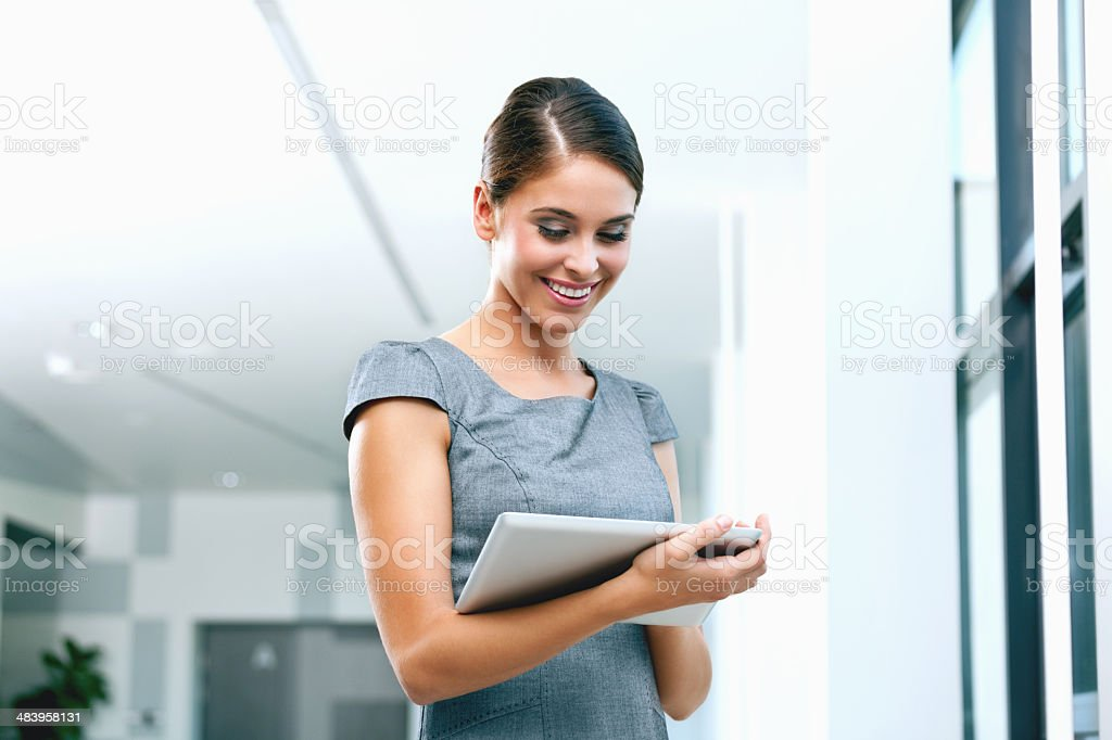 Businesswoman with digital tablet Portrait of an attractive businesswoman using a digital tablet. 25-29 Years Stock Photo