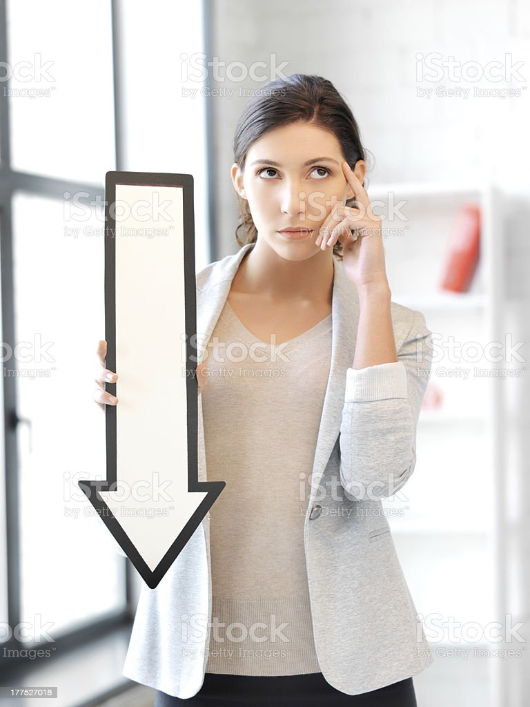 businesswoman with direction arrow sign stock photo