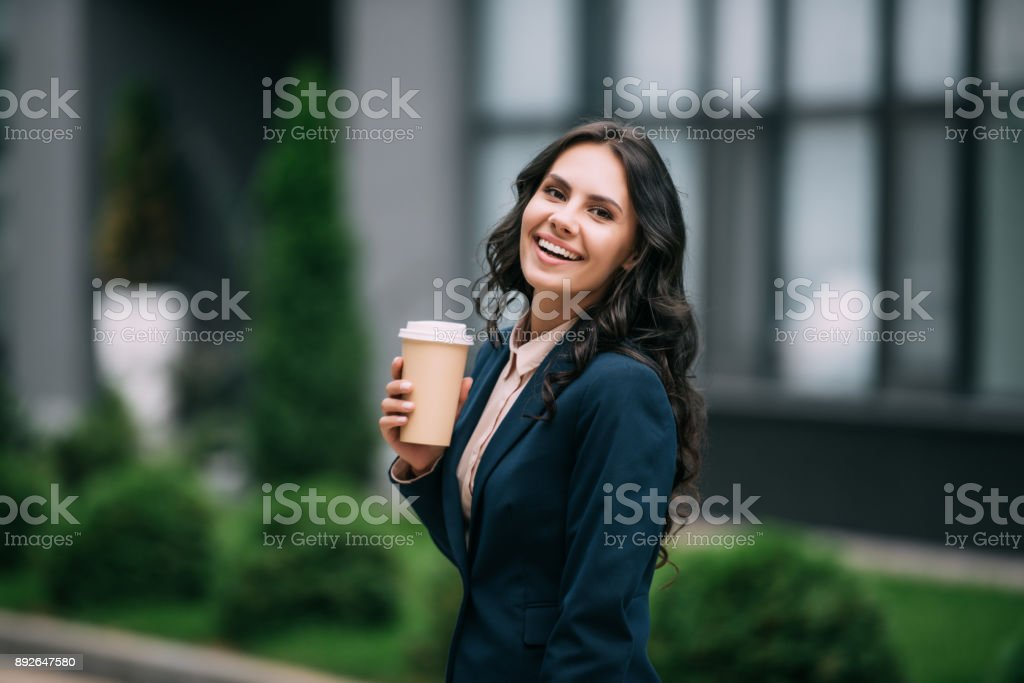 businesswoman with disposable cup of coffee stock photo