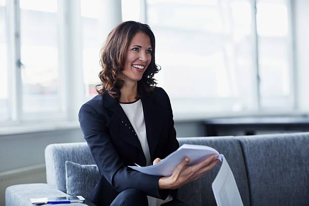 businesswoman with documents in office - netherlands map stockfoto's en -beelden