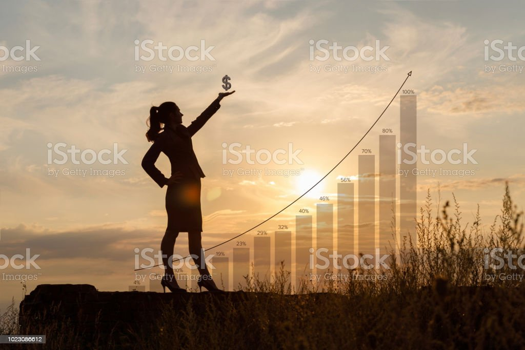 Businesswoman with dollar sign in hand . stock photo