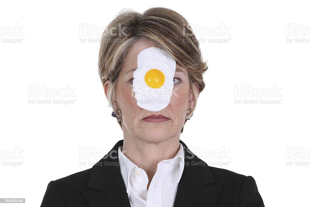 Businesswoman with egg on face stock photo