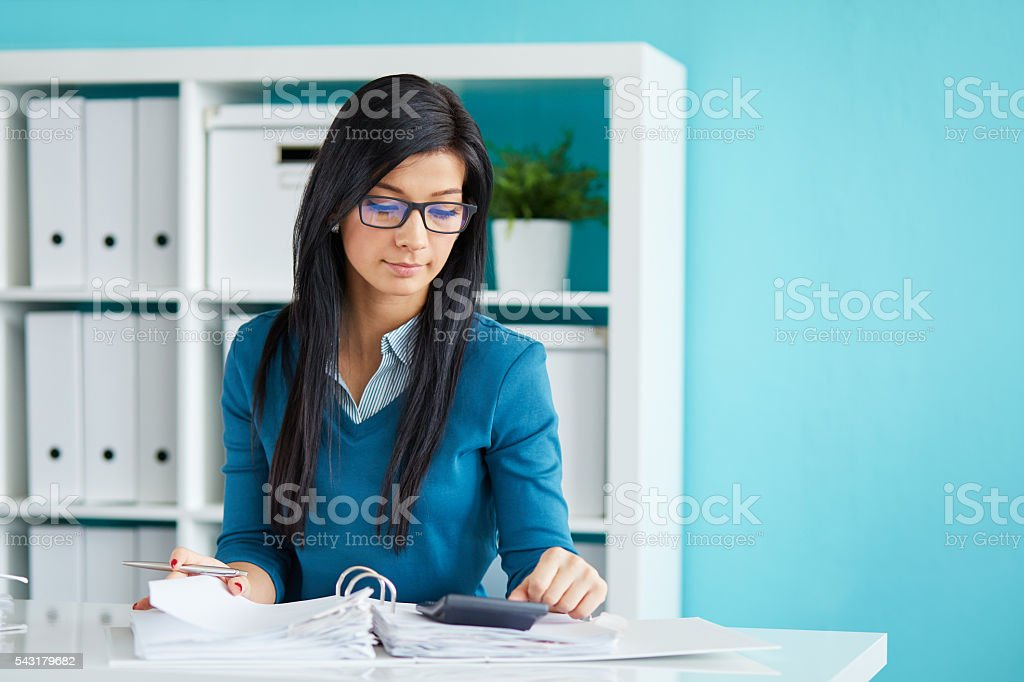 Businesswoman with glasses in office stock photo