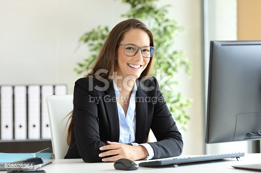 istock Businesswoman with glasses posing at office 638526964