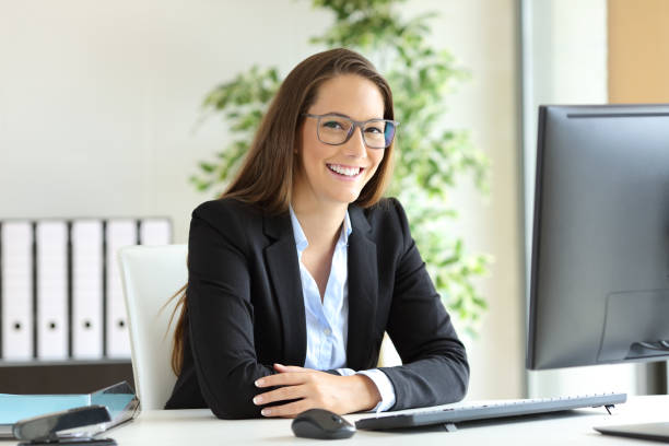 businesswoman with glasses posing at office - assistant stock pictures, royalty-free photos & images