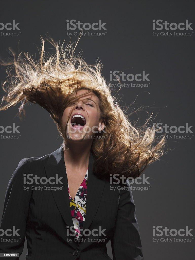 Biznesmenka z włosów wieje w Wiatr zbiór zdjęć royalty-free