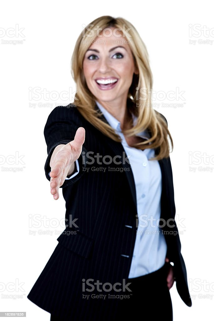 Businesswoman with hand extended outward to shake royalty-free stock photo