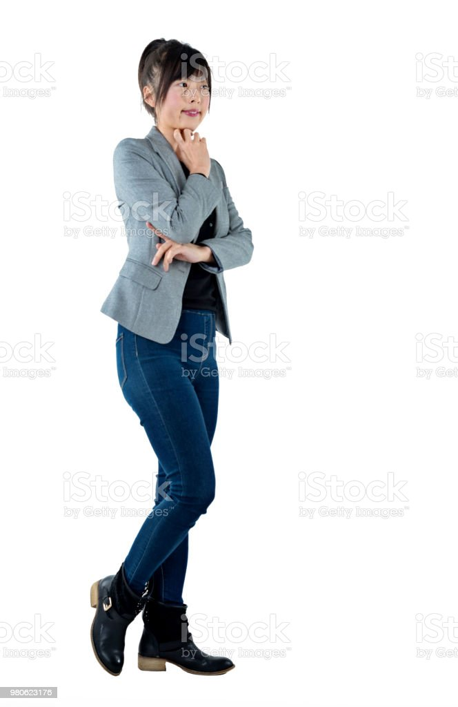 Businesswoman with hand on chin on white background stock photo