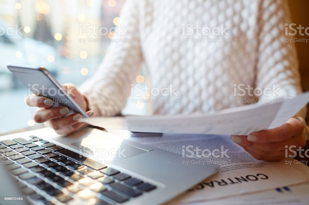Businesswoman with Hands Full of Work stock photo