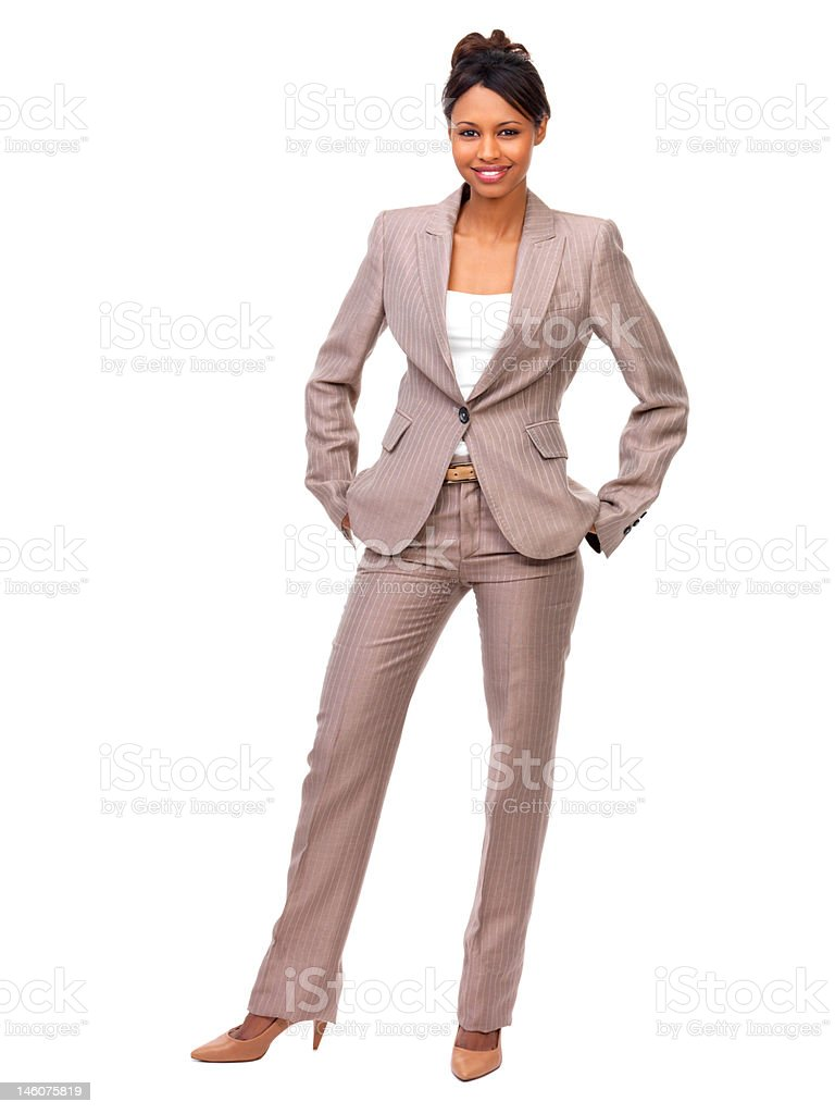 Businesswoman with hands in pockets standing against white background stock photo