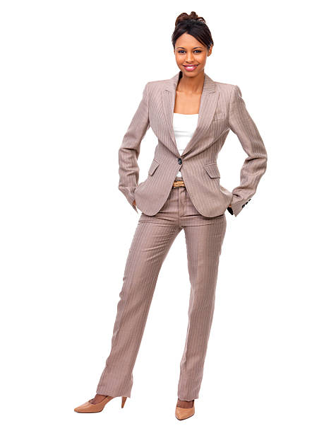 Businesswoman with hands in pockets standing against white background Businesswoman with hands in pockets standing against white background hands in pockets stock pictures, royalty-free photos & images