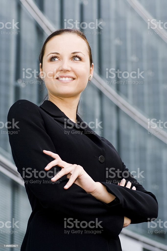 Businesswoman with her arms crossed royalty-free stock photo