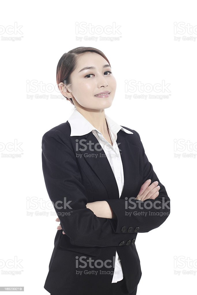 Businesswoman with her arms crossed stock photo