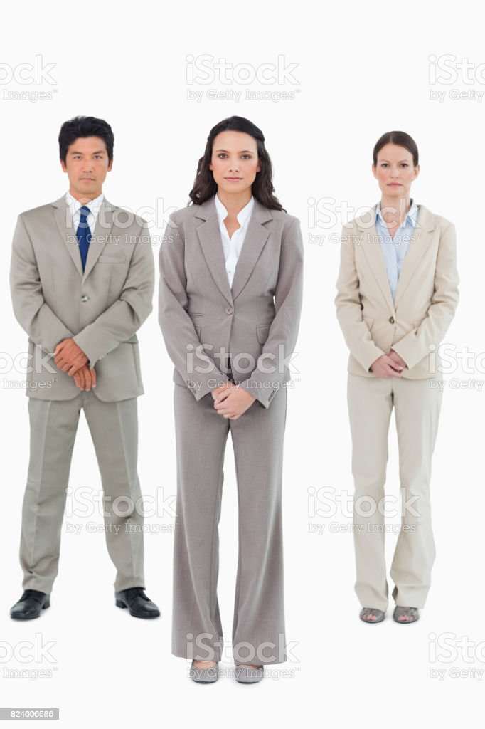 Businesswoman with her team behind her stock photo