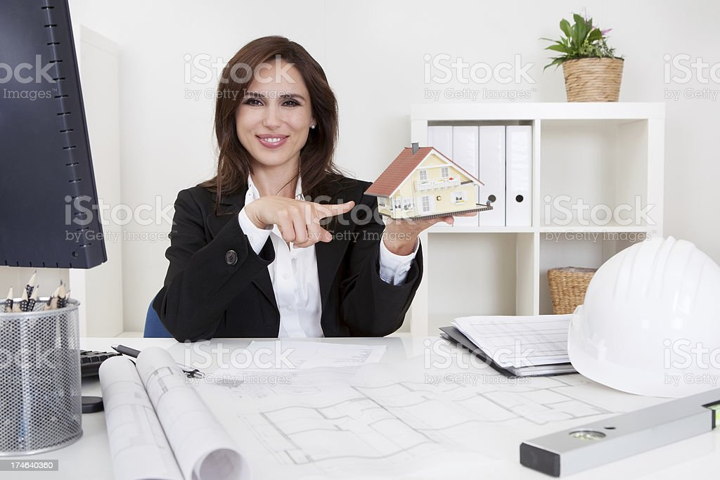Businesswoman With Home Model royalty-free stock photo